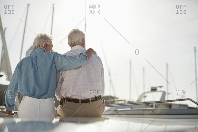 Senior couple sitting together on a yacht