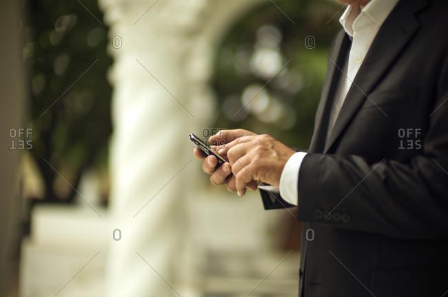 Hands of a businessman using a smart phone