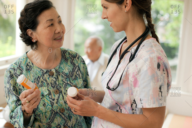 Nurse discussing medication with a senior woman