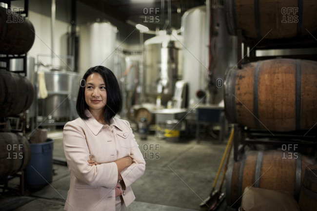 Businesswoman standing in a brewery