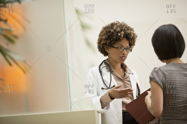 Doctor talking to her patient