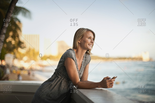 Smiling mid adult woman on a balcony