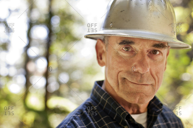 Portrait of a middle aged man wearing a hard hat