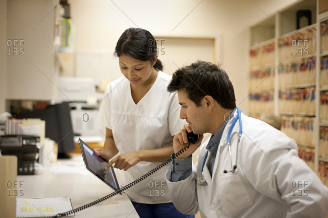 Doctor and nurse looking at a digital tablet