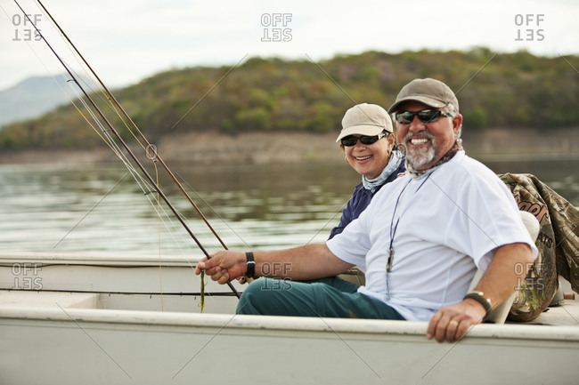 Middle aged couple in a fishing boat