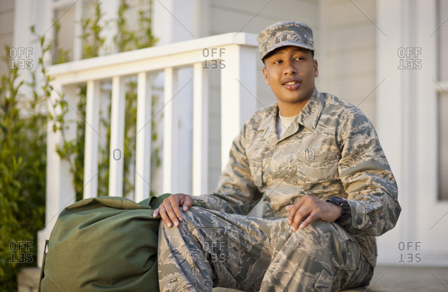 Soldier in uniform sitting on his porch