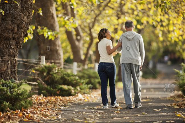 Nurse walking with senior patient