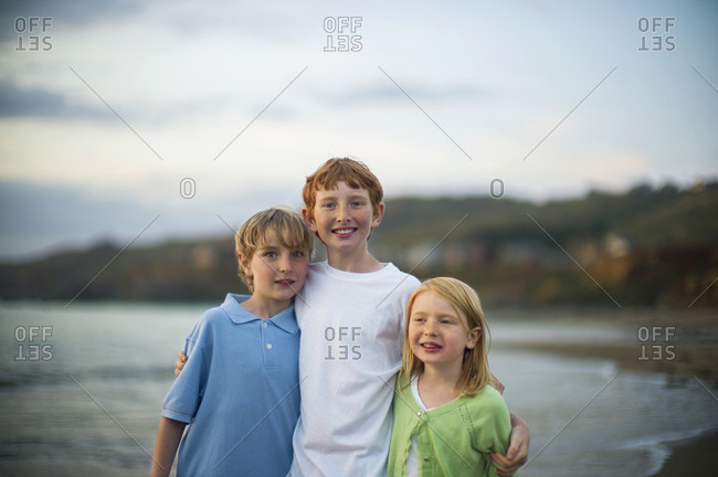 Portrait of siblings at a beach