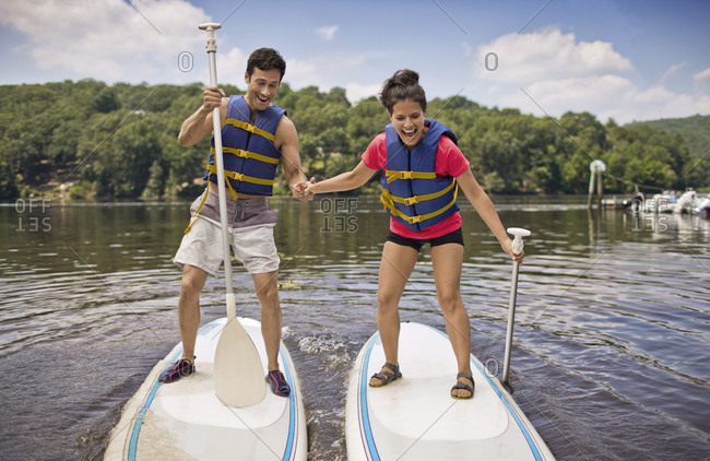 Young couple paddle boarding