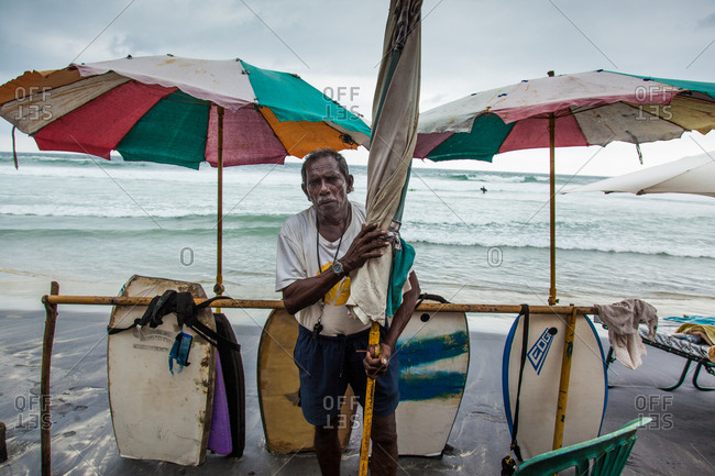 Kerala, India - September 27, 2014: An Indian surf board collector at Kerala, India