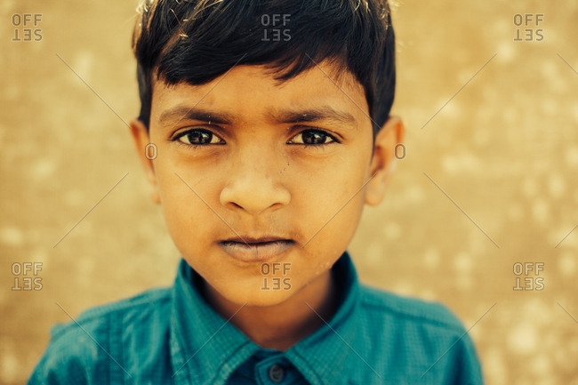 March 28, 2014: Portrait of a young boy in blue shirt.