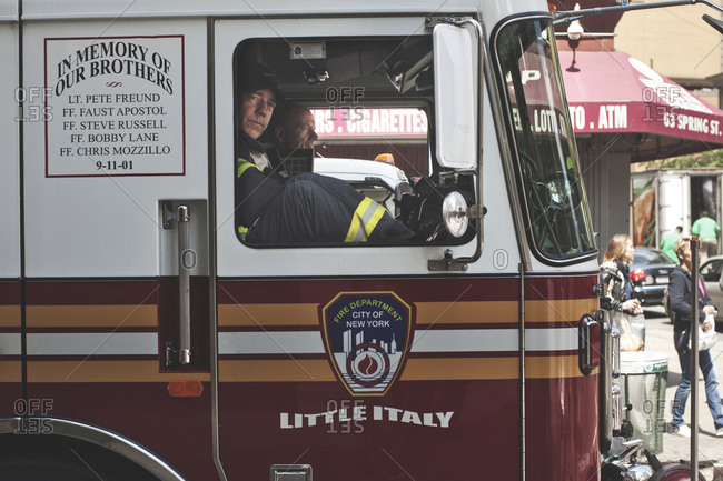 New York, United States of America - May 13, 2013. Firefighters from the fire department seen in a truck in New York City.