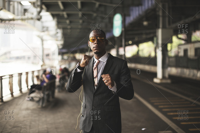New York, United States of America - May 28, 2015. A well-dressed man in a suit showing the classic boxing stance in New York City.