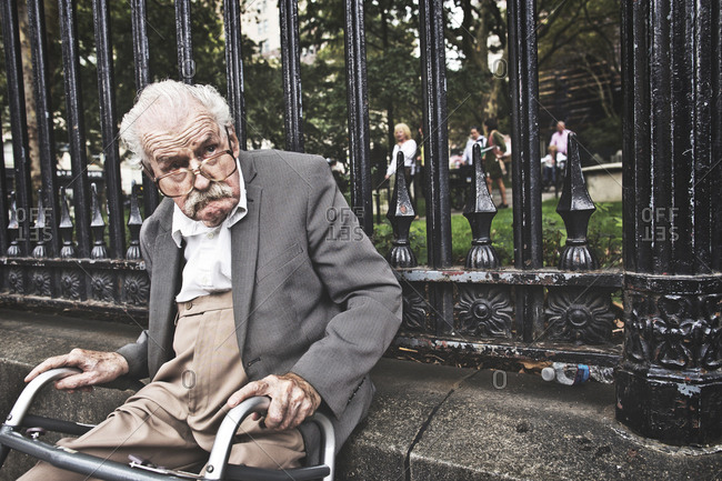 New York, United States of America - September 21, 2014. An old man is resting with his wheeled walker in New York.