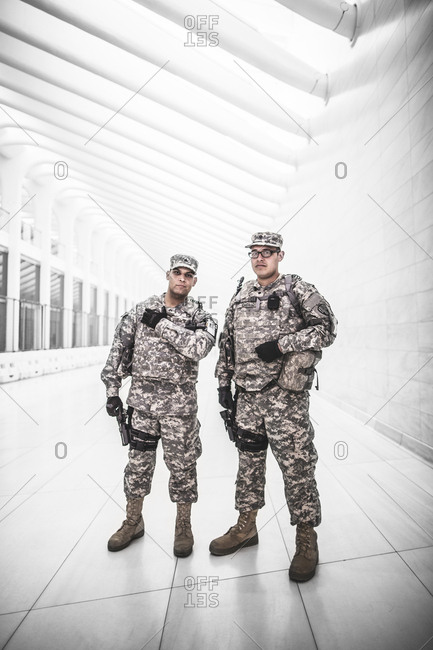 New York, United States of America - May 26, 2015. Two soldiers partrol the World Trade Center Transportation Hub in New York City.