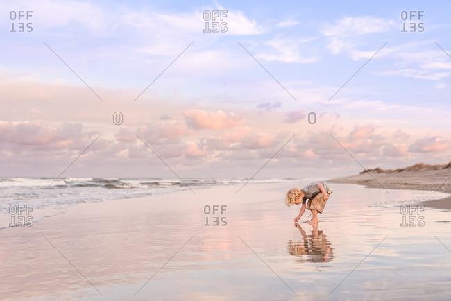 Little boy playing on shore of Nags Head, North Carolina