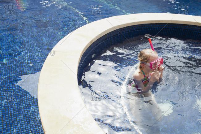 Girl snorkeling in swimming pool