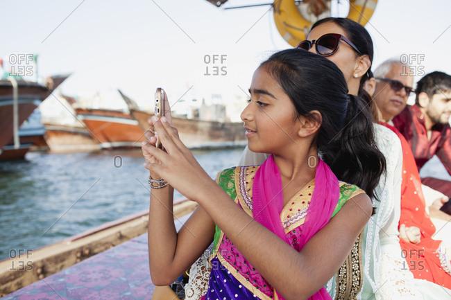 Girl photographing at Dubai Creek