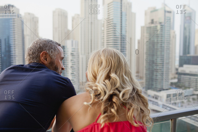 Couple leaning at balcony