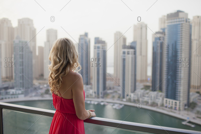 Woman looking out from balcony