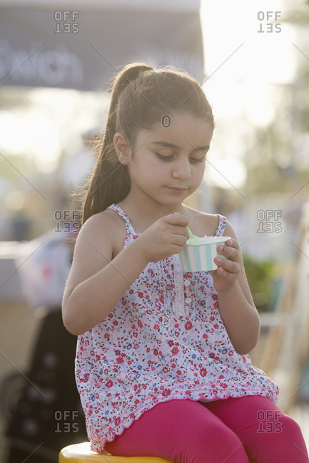 Girl eating ice cream at park