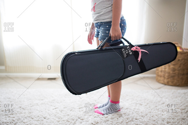 Girl carrying her violin case