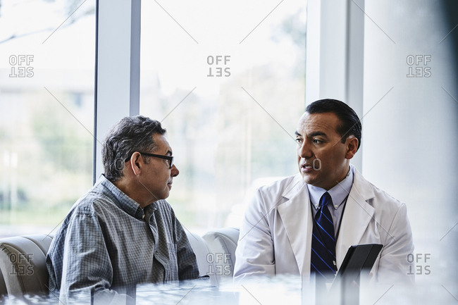 Doctor and patient talking in lobby of medical clinic