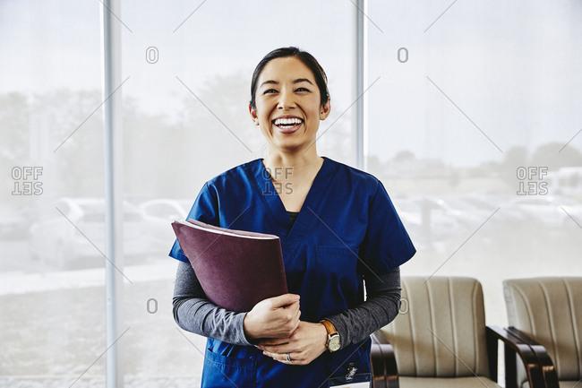 Portrait of cheerful female nurse