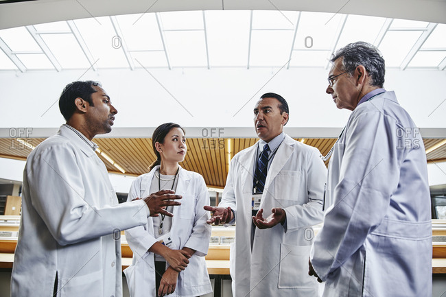 Group of doctors having discussion in hospital