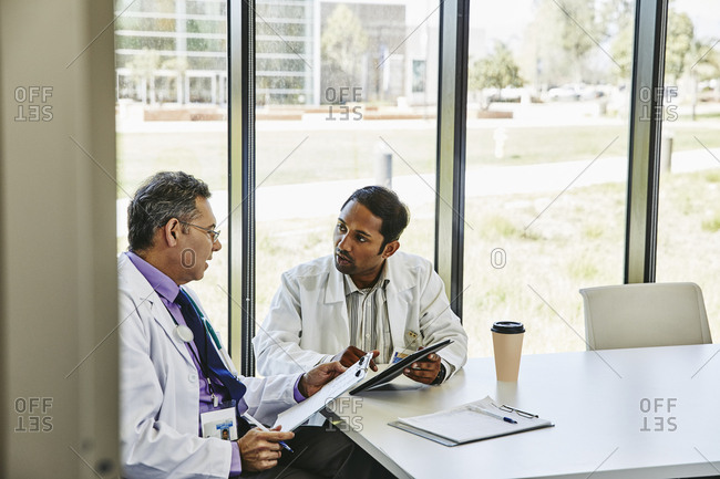 Male doctors discussing in  boardroom at hospital