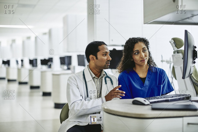 Doctor and nurse working at computer in medical lab