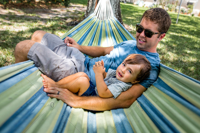 Father and son relax in a hammock