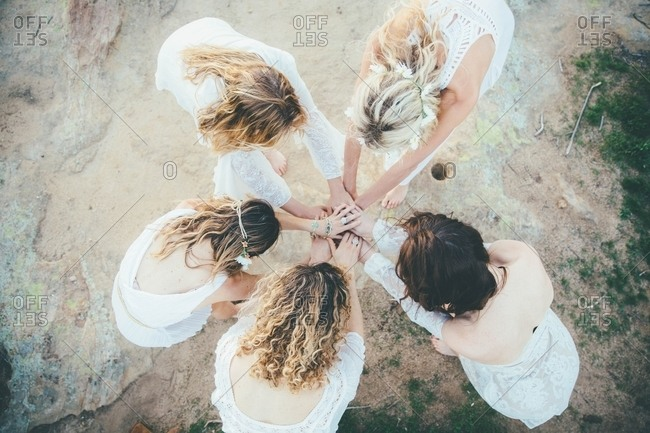 Women making circle with hands