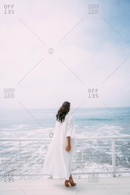 Woman in flowy dress on ferry
