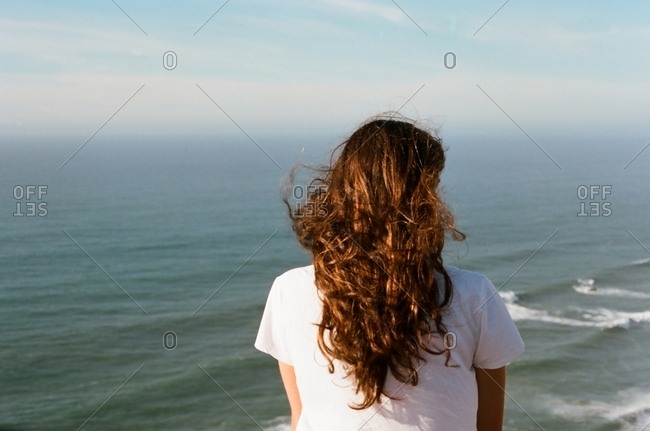 Woman in breeze by the ocean