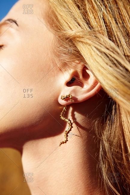 Blonde woman wearing gold earrings