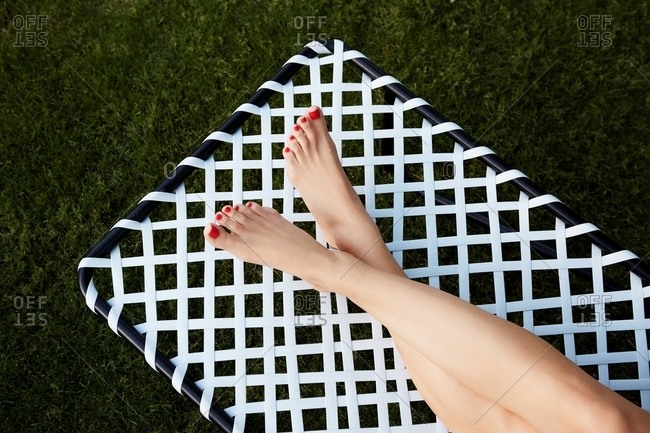 High angle view of woman's legs on a lounge chair