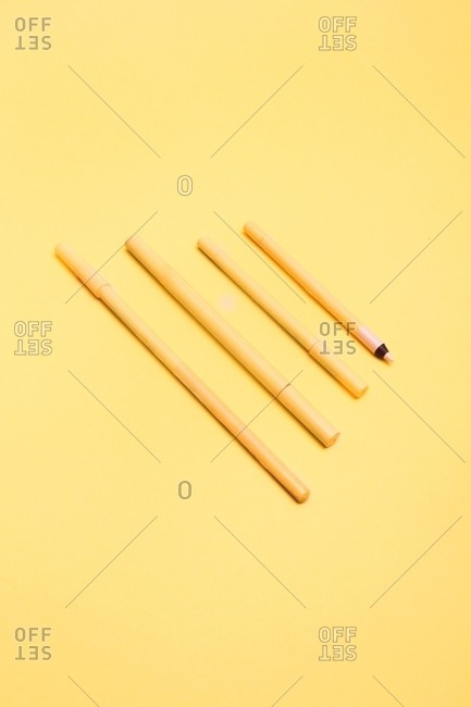 Yellow crayons on a yellow background