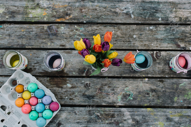 Dyeing Easter eggs on wooden picnic table