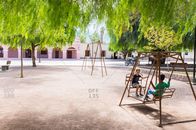 Two children in the playground of a small town in Argentina