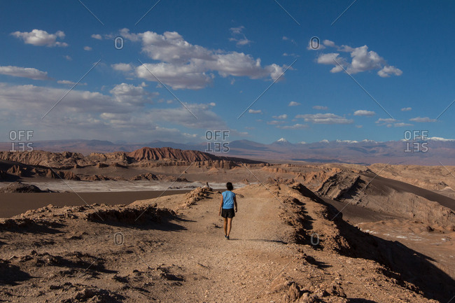 Woman on hiking trail through the Valley of the Moon