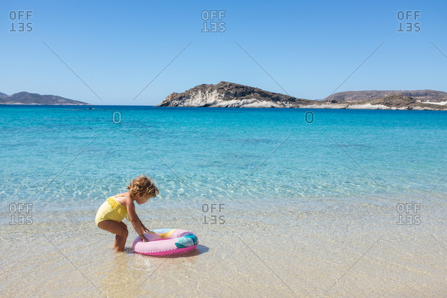 Young girl getting ready to float in the water