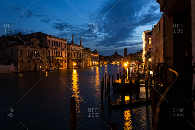 The gondola docks along the Grand Canal at night
