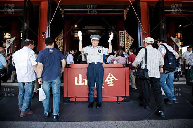 Tokyo, Japan - July 10, 2011: A guard seen at work at the Senso-Ji temple in Tokyo.