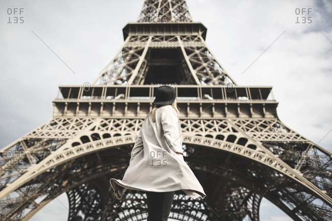 Paris, France - May 13, 2015: A woman is watching the famous Eiffel Tower in Paris.
