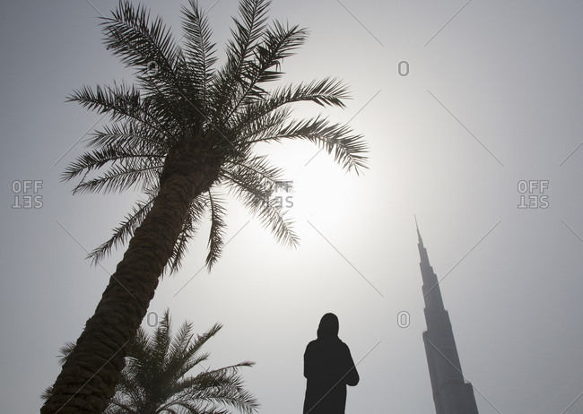 Dubai, UAE - September 16, 2012: Person silhouetted by Burj Khalifa