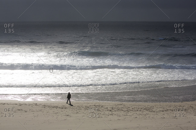 Person silhouetted on Bandon Beach, Oregon