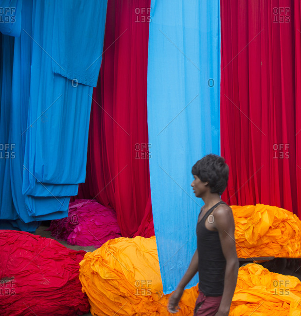 Jaipur, India - October 4, 2013: Man among dyed cloth