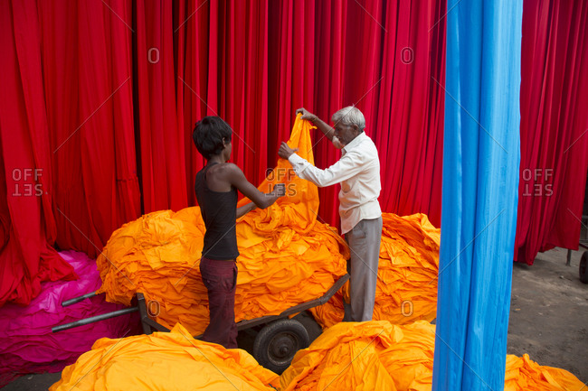 Jaipur, India - October 4, 2013: Men sorting dyed cloth