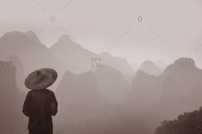 Farmer looking at Guilin mountains, China